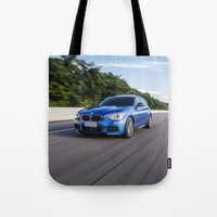 bmw Tote Bags featuring BMW M135i by Nenhum Destes