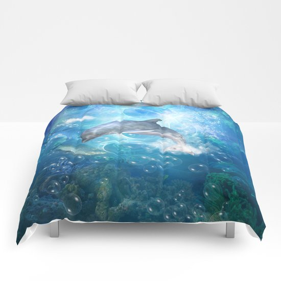 Cute dolphin Comforters