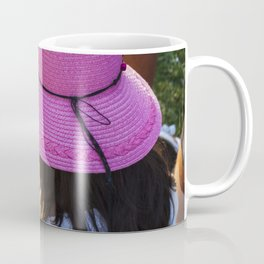 Big pink hat for a child girl on the grass Coffee Mug