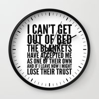 blankets Wall Clocks featuring I CAN'T GET OUT OF BED THE BLANKETS HAVE ACCEPTED ME AS ONE OF THEIR OWN by CreativeAngel