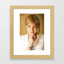 Pretty blonde hair girl  with brown eyes  in the studio  Framed Art Print