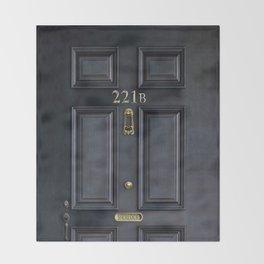 Haunted black door with 221b number Throw Blanket