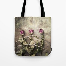 Three dried roses and barbed wire Tote Bag