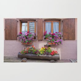 Two Windows and Colorful Flowers Rug