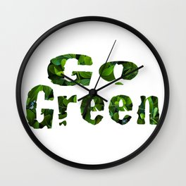 'Go Green' bold text filled in with green leaf coastal plants blossoming white flowers.   Wall Clock