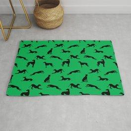 Greyhound Silhouettes on Green Rug