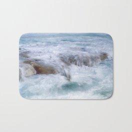 water over rocks Bath Mat