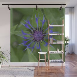 Thin blue flames in a sea of green Wall Mural