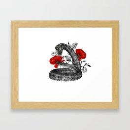 Snake in a garden Framed Art Print