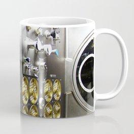 Interior lights give the Microgravity Science Glovebox (MSG) the appearance of a high-tech juke box Coffee Mug