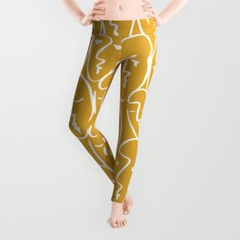 faces / mustard Leggings