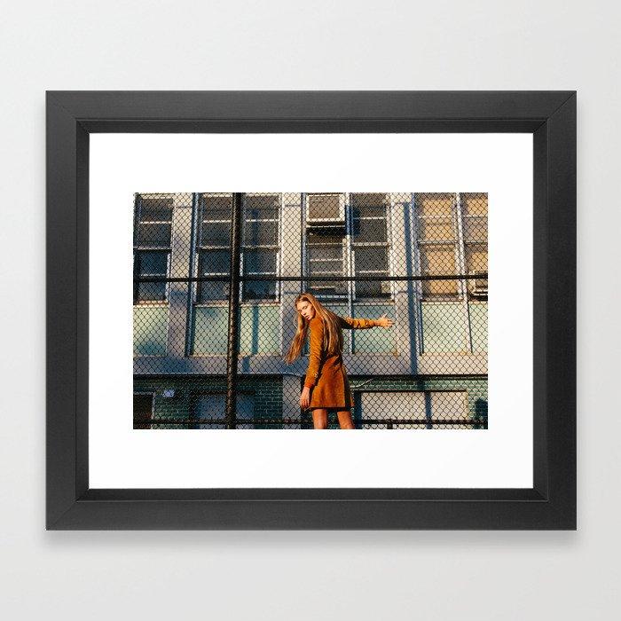 Woman at Golden Hour Fence Framed Art Print