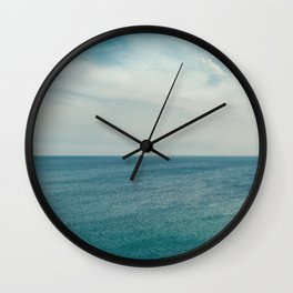 Cliff into the ocean Wall Clock