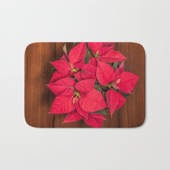 Red Christmas flower on brown wood Bath Mat