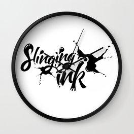 slinging ink - black Wall Clock