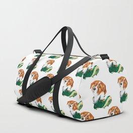 A little dog in a spike Duffle Bag