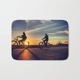 Cycling on sunset in Santa Monica, California, USA Bath Mat