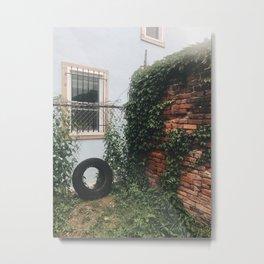 a tire, a yard Metal Print