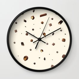 Falling chocolates with cream background Wall Clock