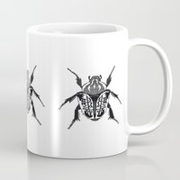 beetle Mugs featuring Beetle by Rhiannon Foster