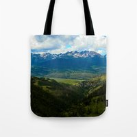 gore Tote Bags featuring Gore Range with ranches below by Calm Cradle Photo & Design