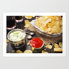 Potato chips with dipping sauces on a rustic table Art Print