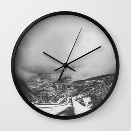 road leading down into a storm Wall Clock