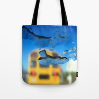 sia Tote Bags featuring yellow bus and ice photography  by Antoine