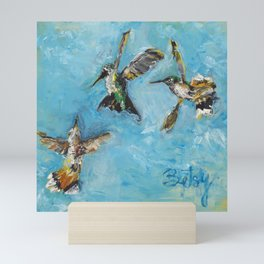 Hummingbird Trio: A Brave Black-chinned takes on the Rufous Twins Mini Art Print