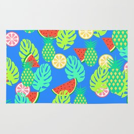 Watermelons and pineapples in blue Rug