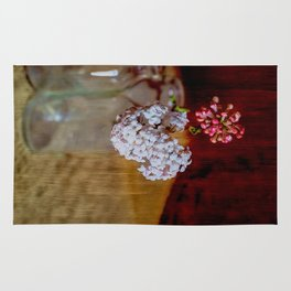 Vintage bottles with Viburnum flowers Rug