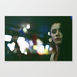 night portrait with shiny out of focus lights Canvas Print