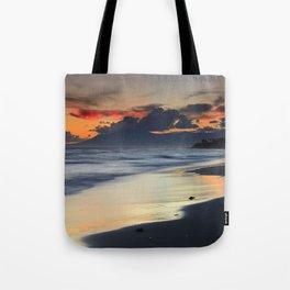 Magic red clouds. Sea dreams Tote Bag