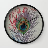 peacock feather Wall Clocks featuring Peacock Feather by Michael Creese