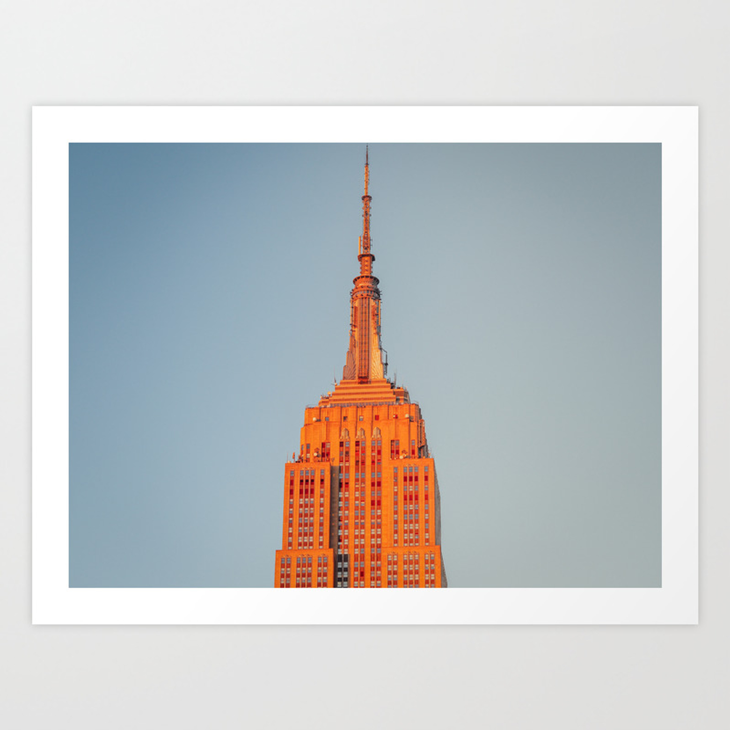 Sun setting on the empire state building art print by themeadiaco society6