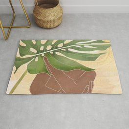 Woman with Monstera Leaf Rug