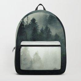 Misty pine fir forest landscape in hipster vintage retro style Backpack