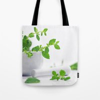 melissa smith Tote Bags featuring Melissa officinalis by Tanja Riedel