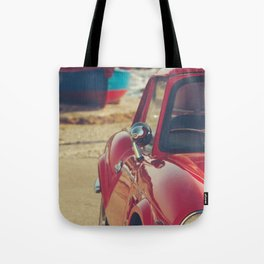 Triumph spitfire, english car by the beach in italy, old car and a boat, for man cave decor Tote Bag
