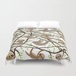funny and cute smiling Three-toed sloth on green branch tree creeper Duvet Cover