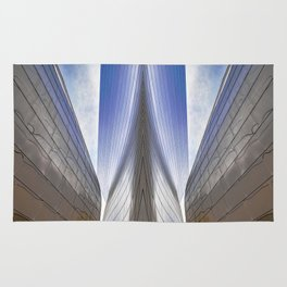 Architectural Abstract of a metal clad building looking skyward Rug