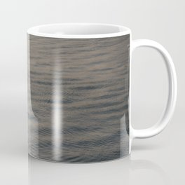 Small boat anchored in the river Coffee Mug