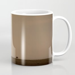 Lone wildebeest grazing in South Africa at sunset Coffee Mug