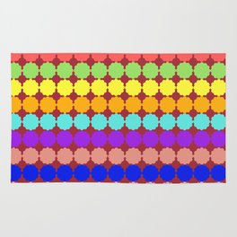 Stylized round multi-colored flowers (red background) Rug