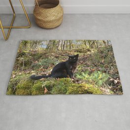 black cat in the forest Rug