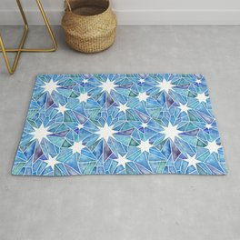 Geometric Crystalline Star Pattern in Blues Rug
