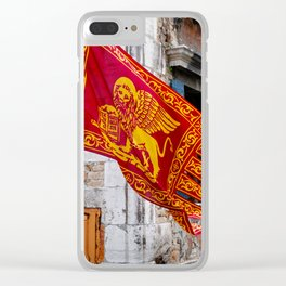 Colors of Venezia, golden-red flag, old building at background Clear iPhone Case
