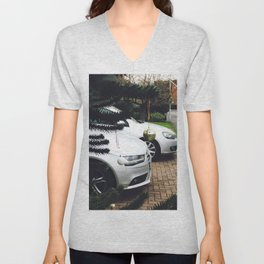 Luxury residential house with cars in front Unisex V-Neck