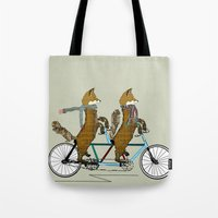 onesie Tote Bags featuring Foxy days lets tandem by bri.buckley