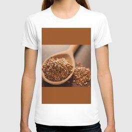 Brown flax seeds heap on wooden spoon T-shirt